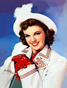 A great colour portrait of Judy Garland in red and white cold weather ensemble. #vintage #actress #1940s