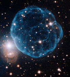This Gemini Observatory image of Kronberger 61 shows the ionized shell of expelled gas resembling a soccer ball. The light of the nebula here is primarily due to emission from twice-ionized oxygen, and its central star can be seen as the slightly bluer star very close to the center of the nebula.