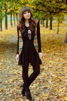 Black dress + multicolored vest via www.chictopia.com