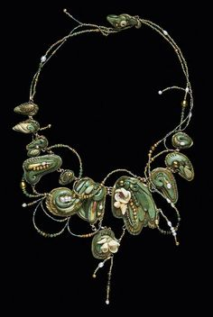 """Title: Second place: Christi Friesen  Description: """"Tendriles and Blossoms""""    13"""" h x 10"""" w x 1"""" d    Premo! Sculpey, fossilized palm, pink tourmaline, crystals, pearls,semi-precious stone beads, 18k gold-filled wires,  rings and spacers, 24k gold-covered flexible cable,  glass beads    Photo by Bernard Wolf"""