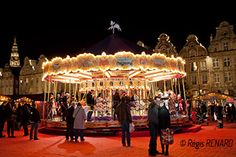 """Manège : Comme dans un conte de fée !  Carrousel à Arras - chevaux de bois -  beffroi- Cette photo fait partie de mon livre d'art sur les manèges intitulé : """"Tours au Coeur de l'Art, Embarquement Immédiat !"""""""