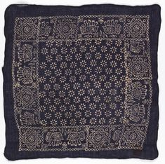 Square bandana with deep blue field and design in white. Field of closely-spaced stars. Border of addorsed elephants and large eight-pointed stars.