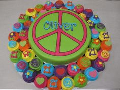 Flower Power Hippie style arrangement with cutting cake in the middle and mini cupcakes around in very bright colours