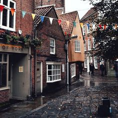 Bunting fallen leaves and the most beautifully wonky Autumn coloured building. Check out the angles on that place!! If you turn left past the orange building you will be on The Shambles one of the best preserved medieval streets here in the UK and a particular favourite of mine  . We're off National Trusting today  Best way to spend a weekend. . Happy Sunday!