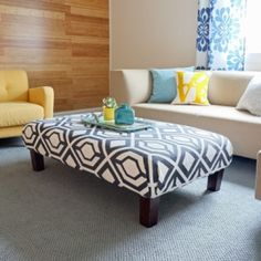 Recover an old ottoman in a graphic flat weave rug.