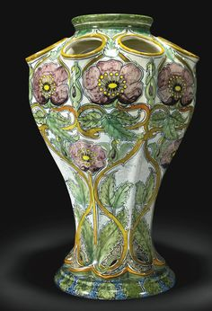 Italian, Florence, Cantagalli factory, circa 1900-1910 FLOWER VASE of octagonal inverted baluster form, the shoulders with eight flower apertures, above a band of large intertwined poppies and swirling foliage on the pale green ground, cockerel mark and 14 in blue, faint printed mark 'Italia' faience , 14 1/2 in. high