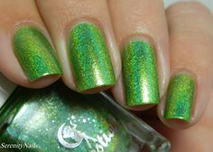 Hella Holo Custom Celestial Cosmetics On The Way to Onomea Bay On The Way To Onomea Bay is a vibrant warm, green apple shade with violet and blue sparks and a linear holographic effect.