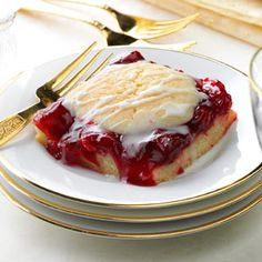 Cherry Cobbler Bars Recipe -Craving an oven-fresh fruit cobbler? This cheery twist on the classic treat is old-fashioned comfort food at its finest. The cherries peeking out of the topping make it a pretty addition to a holiday spread. Feel free to use any flavor pie filling to suit your taste. —Mary Boge, Red Boiling Springs, Tennessee