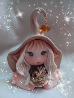 Elfo con cristallo   di Quarzo Ialino placcato oro