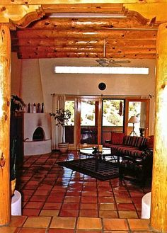 Southwestern living room with saltillo tile and vigas