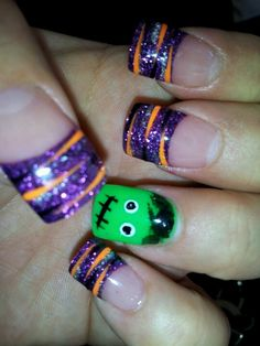 Halloween Nails Frankenstein with Orange Black n Silver Zebra Stripes over a Purple Shimmer Gel Nail. Love how these turned out. Bwaaahaahaahaaa