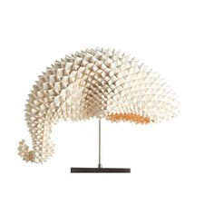 Lightology Dragon's Tail Table Lamp--a unique lighting creation of Origami. Two 40 watt. Seen on fireplace mantle, Elementary TV show