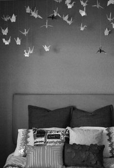 Origami cranes decorating a bedroom