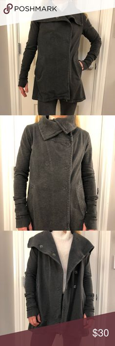 Lululemon charcoal grey stretch cotton coat This jacket is so versatile, throws perfectly over workout wear or to run around over jeans and t-shirt. Cute detailing like patched elbow sleeves, fold over neckline, thumb hole to hold down sleeves, longer in back for rear end coverage, and drawstring hemline. Double breasted snap closure. Lululemon size 4. lululemon athletica Jackets & Coats Pea Coats
