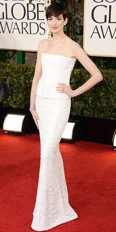"Anne Hathaway  ""It showed up yesterday morning, and I tried it on and just felt like myself,"" said Anne Hathaway about her strapless white Chanel column gown. Hathaway was nominated for Best Performance by an Actress in a Supporting Role for Les Miserables."