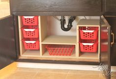 This article makes me want to organize ALL of my cabinets right now! Easy DIY organizer / organizing station for under the sink -- all with baskets from the dollar store. So cool!