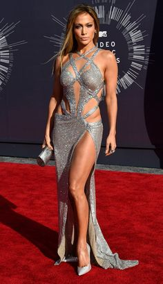 """<p>This perennial Fly Girl knows how to show off her body (<a rel=""""nofollow"""" href=""""https://www.yahoo.com/celebrity/blogs/celeb-news/jennifer-lopez-reveals-where-she-keeps-daring-versace-140016021.html"""">tropical-print Versace dress,</a> anyone?) and gave her leg and toned tummy the spotlight at the 2014 MTV VMAs. The smoldering stare was a bonus. (Photo: Getty Images) </p>"""