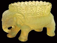 This Victorian Era novelty glass in the form of an elephant vase was produced by Burtles, Tate & Co. of Manchester, England. Photo via Dave Peterson at VaselineGlass.org