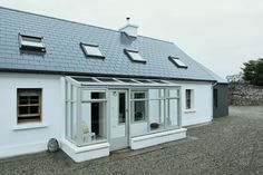Deirdre's dark, daring cottage on the outskirts of Galway City House Design, Summer House, House Plans, Cottage House Designs, Glass Doors Patio, Cottage, Cottage Extension, Farmhouse Renovation, Irish Cottage