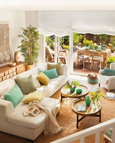 beautiful living space with access to patio area and teal accents