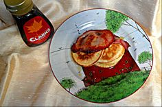 American style pancakes with crispy bacon and maple syrup