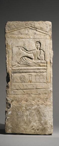 An Egyptian Limestone Stele, Roman Period, 2nd/3rd Century A.D.