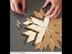 Burnt matchsticks on cardboard shape.