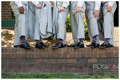 Groom and groomsman showing off matching socks