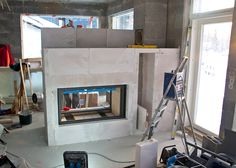 Installing a Stuv 21/125 double face fireplace in a villa in Finland