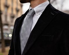 Black velvet jacket and glen plaid tie.
