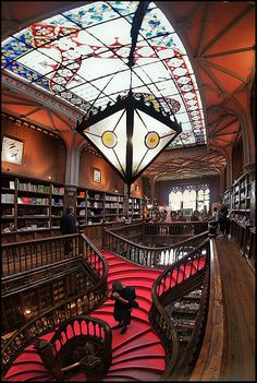 Discover Livraria Lello in Porto, Portugal: One of the most beautiful bookstores in the world hides a neo-Gothic interior behind an art nouveau facade. Places Around The World, The Places Youll Go, Places To See, Around The Worlds, Livraria Lello Porto, Beautiful Library, Spain And Portugal, Portugal Travel, Places To Travel