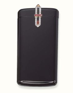A DELICATE ART DECO ONYX, DIAMOND AND RUBY CASE, BY CARTIER Designed as an oblong onyx case, the top enhanced by rose-cut diamond, calibré-cut and cabochon ruby detail, circa 1925, 8.5 x 4.5 x 0.5 cm, with French assay mark for platinum Signed Cartier, no 4579