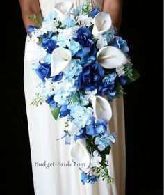 cascading bouquet with royal blue roses, with light blue delphinium, white hydrangea and 8 white calla lilies. This bouquet is approx 16 inches long and 9 inches wide Cascading Wedding Bouquets, Blue Wedding Flowers, Cascade Bouquet, Bride Bouquets, Bridal Flowers, Blue Flowers, Wedding Colors, Purple Orchids, Wedding Blue