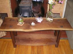 Love the rustic warmth of live edge wood furniture