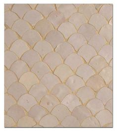 Moroccan-style fish scale tiles....I'm inspired to install as a backslash in my kitchen.....