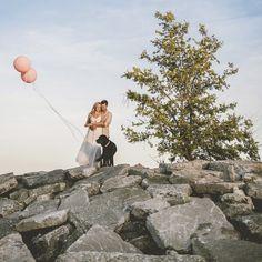 Creative engagement Photoshoot with Megan + Nick at the Toronto Beaches with their black lab, Lou. #balloons #eshoot #fun #animallove #petwedding #blacklab www.brightsidefilms.com