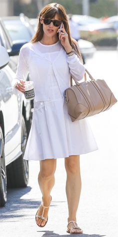 Garner proved that white after Labor Day is a fashion do! She layered a crisp white cardigan over a sculpted little white dress, accessorizing with a nude carryall and flats.