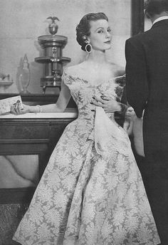 Mary Jane Russell, July Vogue 1953 by Henry Clarke Mary is wearing a dress of 100% Du Pont Dacron - a lace pattern on grey, designed for Joseph Halpert by Jacques Fath.