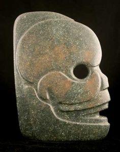 "Mayan Jade Hacha in the Form of a Skull - CK.0616 Origin: Mesoamerica Circa: 300 AD to 900 AD Dimensions: 8.5"" (21.6cm) high x 6"" (15.2cm) wide x 2"" (5.1cm) depth Collection: Pre-Columbian Medium: Jade $48,000.00 Location: United States"