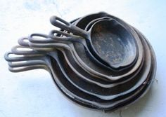 This stack of garage sale skillets can be restored to usefulness with a little work. (Pantenburg photo)
