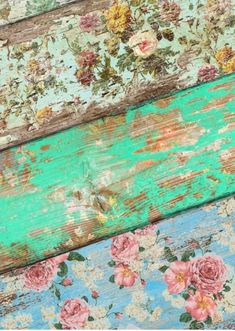 Shabby chic...wall paper sanded off of wooden boards to hang on the fence?