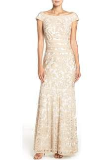 Free shipping and returns on Tadashi Shoji Sequin Lace Gown (Regular & Petite) at Nordstrom.com. Pintuck pleating adds to the elegance of a dreamy V-neck gown that flows into a floor-skimming skirt sparkling with sequined lace. Sheer three-quarter sleeves heighten the romance of this style, while a crisscrossing woven-style bodice slims the silhouette.