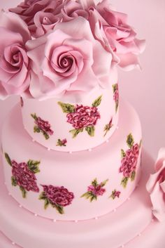 Cakes Haute Couture; pink wedding cake with painted flowers and roses on top