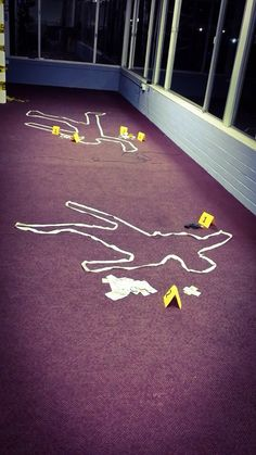 Crime scene decoration simply used masking tape and yellow paper. Police party law and order themed