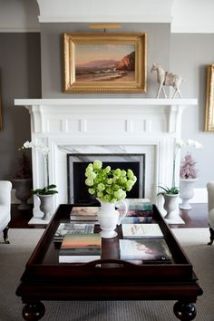 grey walls, very similar to ours. love the fireplace and coffee table styling!