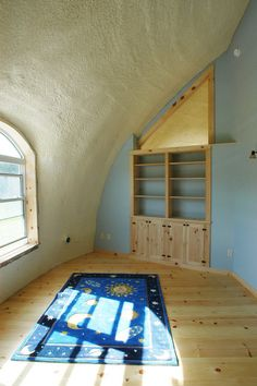 Monolithic Dome bedroom. I love the pine trim and floor.