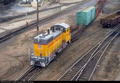 A recently-rebuilt EMD SW9, now Union Pacific SW10 No. 1221, switches tracks near the shop that rebuilt the locomotive at Omaha, Nebraska, in July 1981.