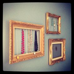 DIY jewellery display using old picture frames.