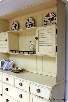 Second-hand stores get colonial-style hutches all the time and they are typically inexpensive - just remove some of the trim and give it a distressed coat of paint for a great new look
