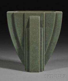 171: Claude Dumas Art Deco Pottery Vase Molded glazed e : Claude Dumas Art Deco Pottery Vase Molded glazed earthenware France, second quarter 20th century Reverse arch form with flattened sides moulded with geometric and curved extensions in relief, matt olive green glaze, raised maker's marks on base, ht. 7 3/4 More